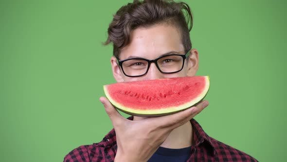 Cover Image for Young Handsome Teenage Nerd Boy with Slice of Watermelon