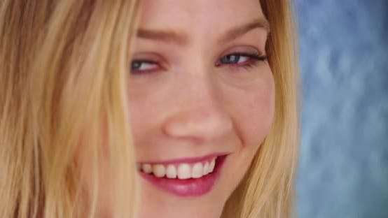 Thumbnail for Close up of smiling happy laughing millennial blonde woman with blue eyes