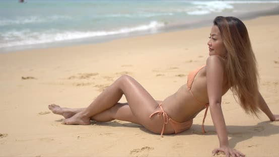 Ethnic Woman Tanning on Beach