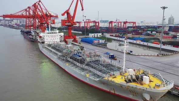 Aerial Footage Of A Large Cargo Ship Berthing At The Dock V3