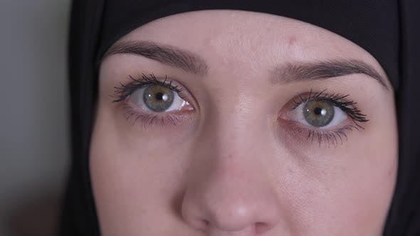 Thumbnail for Extreme Close-up of Hazel Eyes of Sad Muslim Woman in Traditional Black Hijab