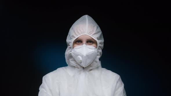 Woman Doctor Wearing White Protective Medical Uniform PPE Suit Coronavirus Protection Dangerous