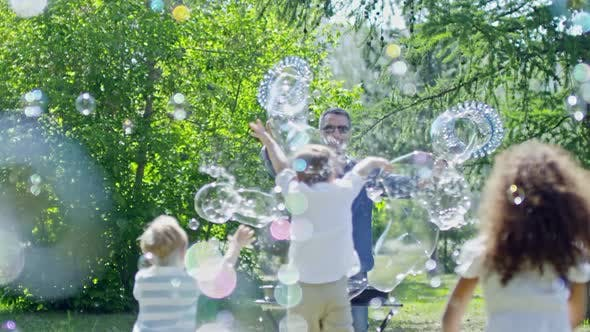 Cover Image for Little Children Playing at Outdoor Bubble Show