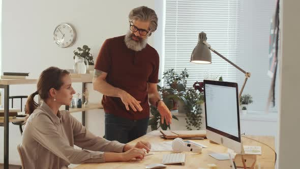 Experienced Business Mentor Talking to Young Female Employee