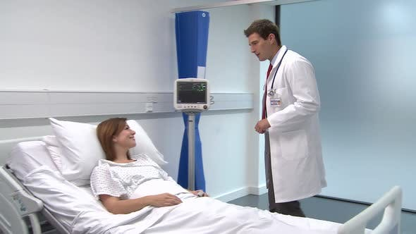 Thumbnail for Male doctor checking on female patient