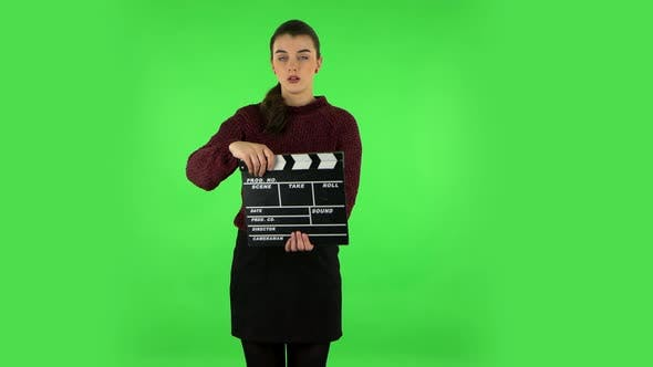 Thumbnail for Girl Holding a Movie Slate Board. Green Screen