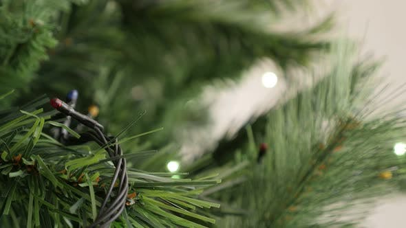 Thumbnail for Colorful dot  bulbs in a  row blinking on Christmas tree close-up 4K 2160p 30fps UltraHD footage - N
