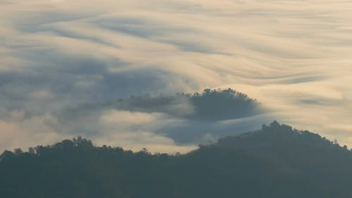 Fog Moving Along Mountain Peak