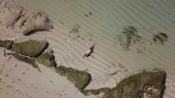Thumbnail for Top View of a Girl Lying on Beach