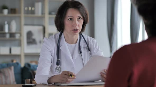 Thumbnail for Old Lady Doctor Discussing Treatment with Patient in Clinic