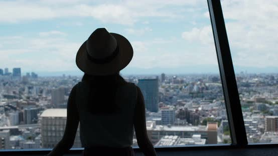 Thumbnail for Woman enjoy the view of Tokyo city at observation deck