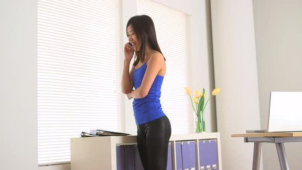 Thumbnail for Asian businesswoman speaking on the phone