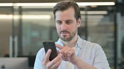 Man Using Smartphone Browsing Internet