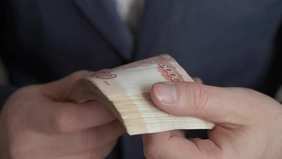 Thumbnail for Male Hands Counting Money. Russian Money Banknotes of 5,000 Rubles