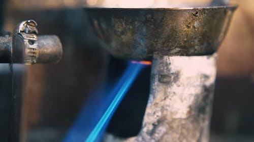Heating Metal Bowl with Burner to Process Jewelry Closeup