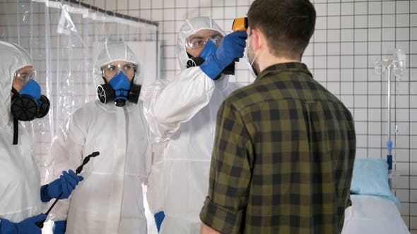 Thumbnail for Team in protective suits temperature measuring of a civil