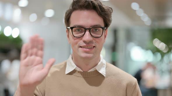 Beautiful Young Male Designer Waving Welcoming