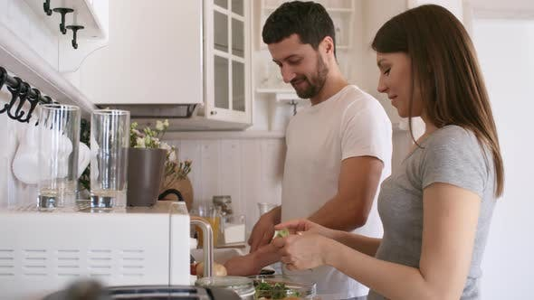 Thumbnail for Cheerful Couple Making Breakfast and Chatting