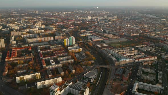 Thumbnail for View of City From Above with Train Passing Through Urban Area with Apartment Buildings in Autumn