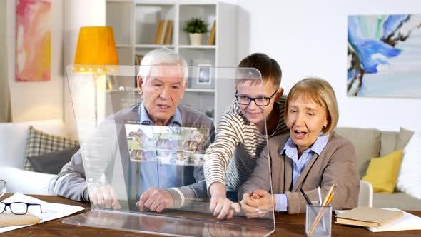 Thumbnail for Little Boy Teaching Grandparents to Use AR Computer