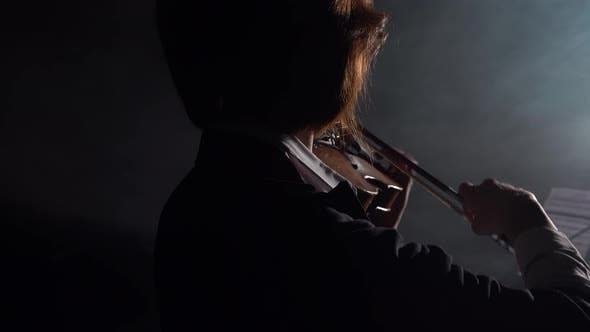 Thumbnail for Dark Studio Where a Musician Plays the Violin While Standing with His Back. Black Smoke Background
