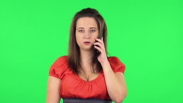 Thumbnail for Portrait of Cute Girl Talking for Mobile Phone, Very Shocked Then Rejoice. Green Screen