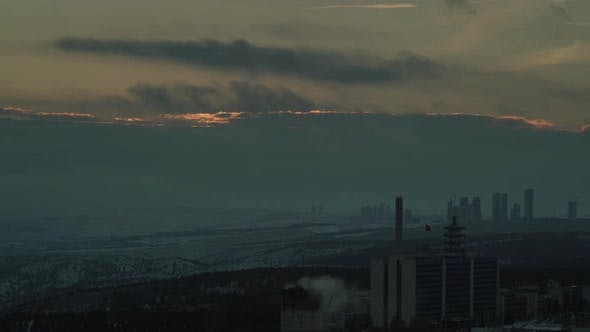 8K Air Pollution in the City at Sunset in Winter