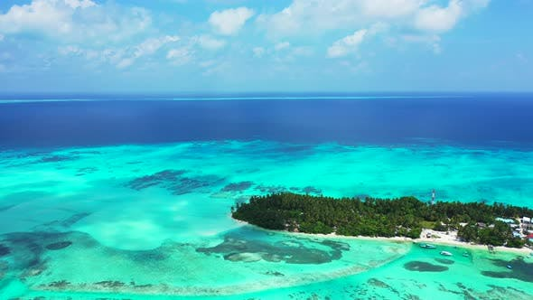 Thumbnail for Wide angle flying clean view of a white sand paradise beach and blue ocean background in colourful 4