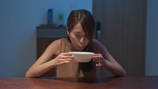 Thumbnail for Woman drink of hot soup at home