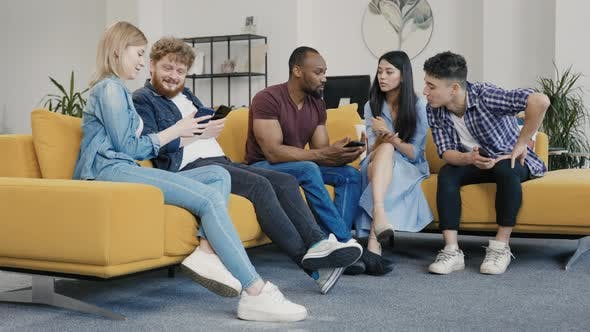Diverse Group of Young Creative Startups Discuss Startup of New Mobile Application