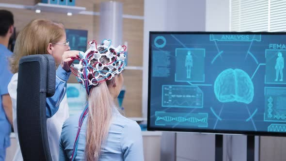 Female Patient Looking at Her Brain Activity on Tv Screen