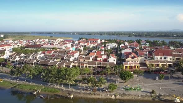 Thumbnail for Aerial View Red Roof Houses and Trees Between Blue Rivers