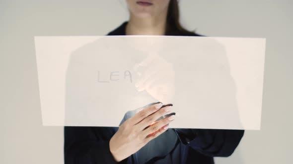 Corporate Woman Writing Leadership On A Board