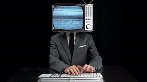 Man Typing TV Head Showing Glitch Disortion Screen
