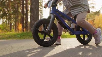Close Up of Unrecognizable Child on Balance Bike