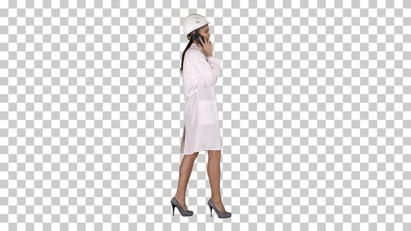 Thumbnail for Female science engineer making a call while walking, Alpha Channel