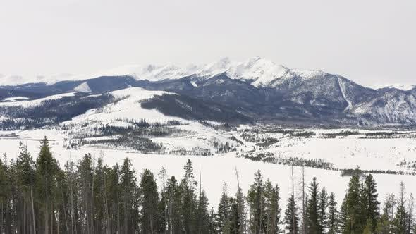Thumbnail for Flying Over Winter Trees Reveal Snowy Rocky Mountain Valley Near Breckenridge Colorado