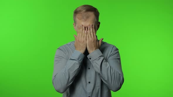 Thumbnail for No, Don't Want To Look This. Scared Upset Man Covering Face and Eyes with Hands, Hiding From Fear