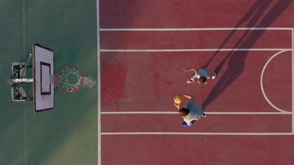 Thumbnail for Aerial View. Father and Son Playing Basketball on Court Outdoors.