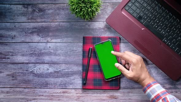Thumbnail for High Angle View of Man Hand Using Smart Phone with Green Screen