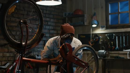Thumbnail for Man Working in a Bicycle Repair Shop