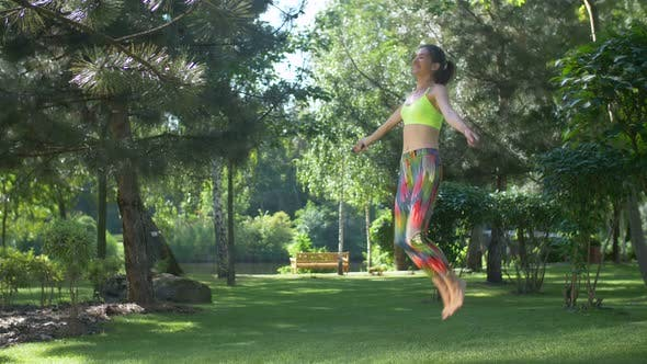 Thumbnail for Fitness Female Doing Skipping Workout Outdoors
