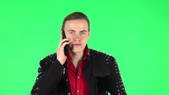 Thumbnail for Guy Speaking Via Telephone. Green Screen