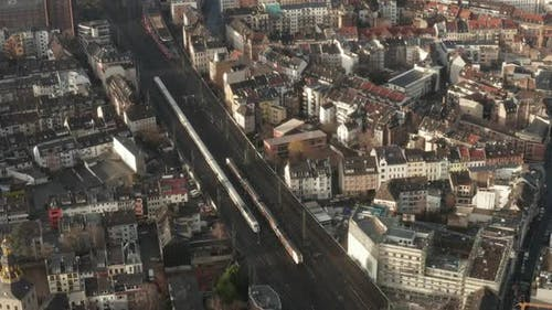AERIAL: European Railway System in Cologne Germany with Two Trains Crossing