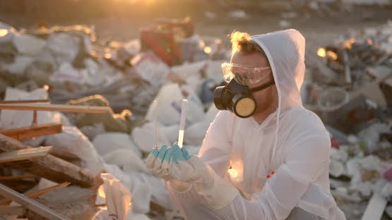 Researcher at Plastic Landfill Analyzing Environmental Pollution Level