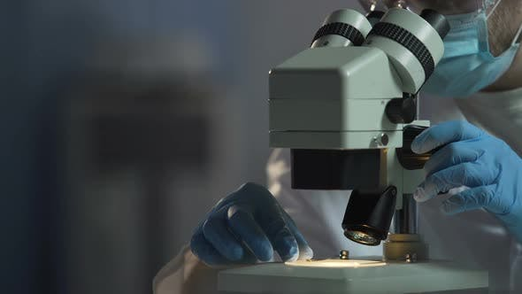 Thumbnail for Scientist Adjusts Microscope to See Cell Molecular Compound, Microbiology
