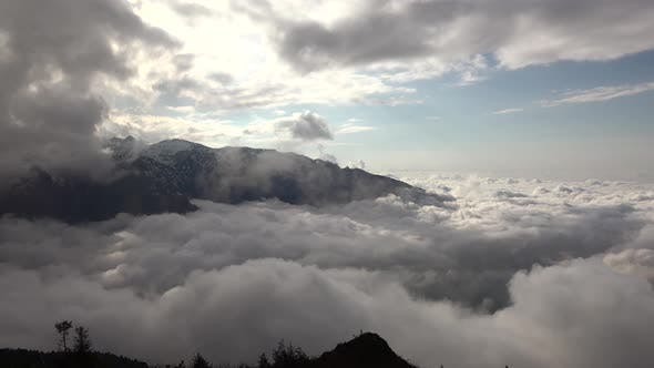 Thumbnail for High Snowy Mountains Between Two Layers of Above Clouds
