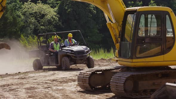 Thumbnail for Construction workers driving utility vehicle on job site