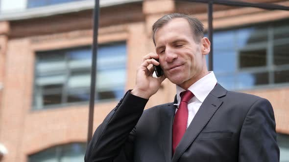 Thumbnail for Phone Talk by Businessman