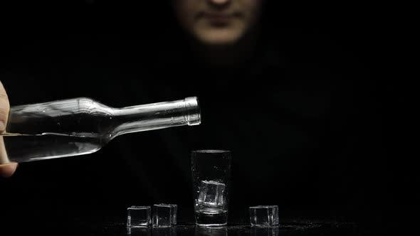 Thumbnail for Barman Pour Frozen Vodka From Bottle Into Shot Glass with Ice and Take It